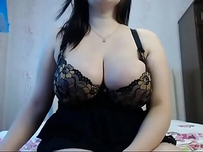 Big boobed russian stretching on the couch in pretty cam