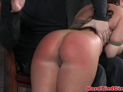 Ball gag brunette bent over and spanked