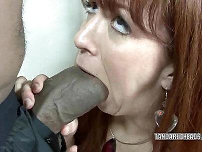 Redhead Goldie Handling a Black Cock!