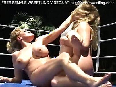 Beautiful darkhaired lesbian feasting on jizz loaded boobs