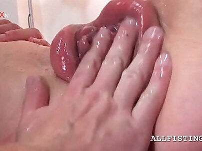 Kinky babe gets her pink pumped cunt fisted hard